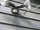 Hardboard siding damaged in Florida when power drop yanked out